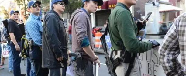史无前例!美国华人持枪参加维权游行
