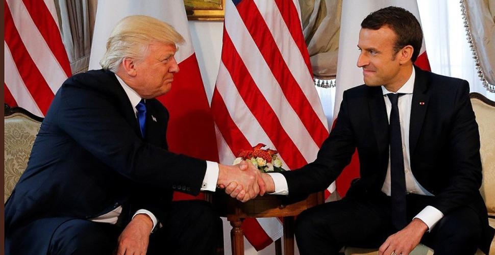 """特朗普与马克龙""""握手之战"""" 手被捏变形"""